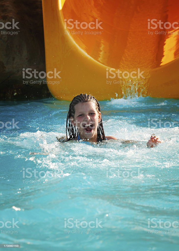 Little girl diving in pool stock photo
