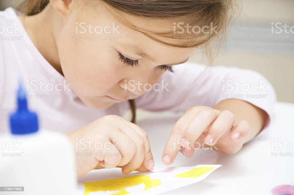 Little girl doing arts and crafts in preschool royalty-free stock photo