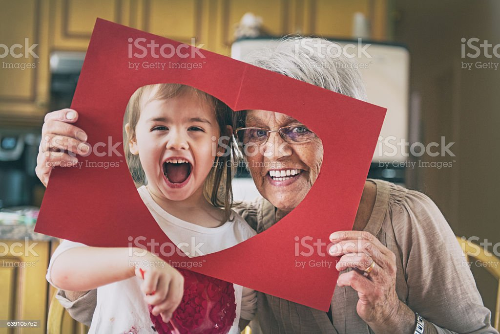 Little girl doing bricolage with grandmother stock photo