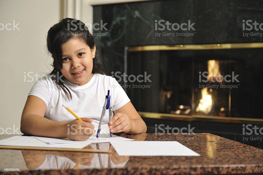 Little girl doing her math homework royalty-free stock photo
