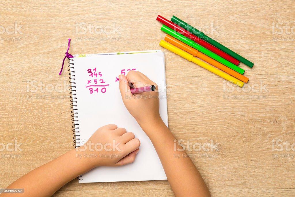 Little girl doing homework stock photo