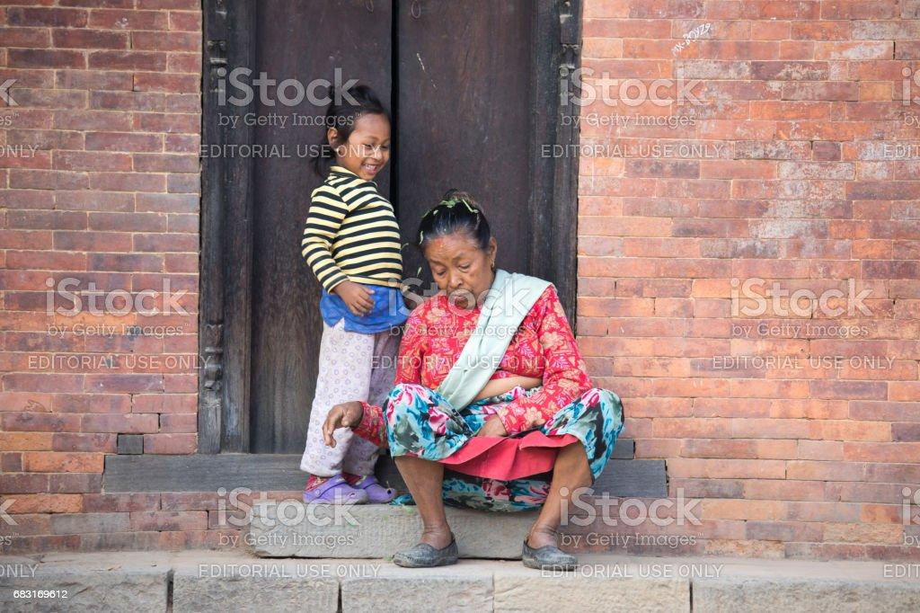 Little girl doing mischief. stock photo