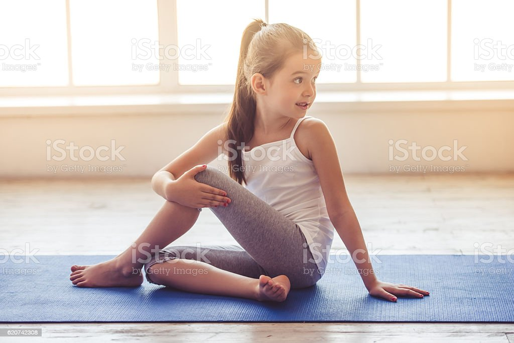 Little girl doing sport stock photo