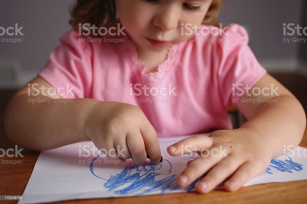 Little Girl Drawing a Picture in School Desk royalty-free stock photo