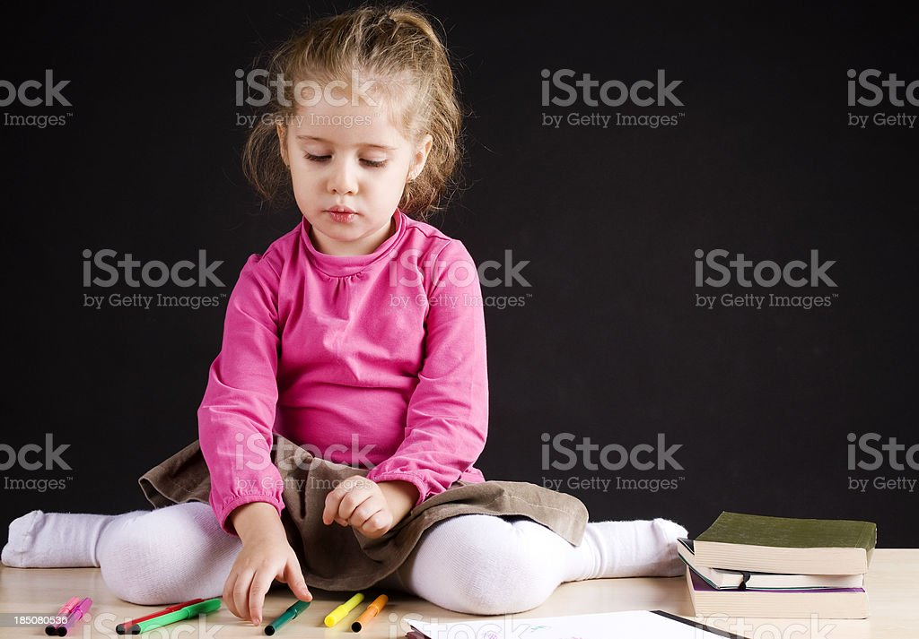Little girl drawing in class royalty-free stock photo