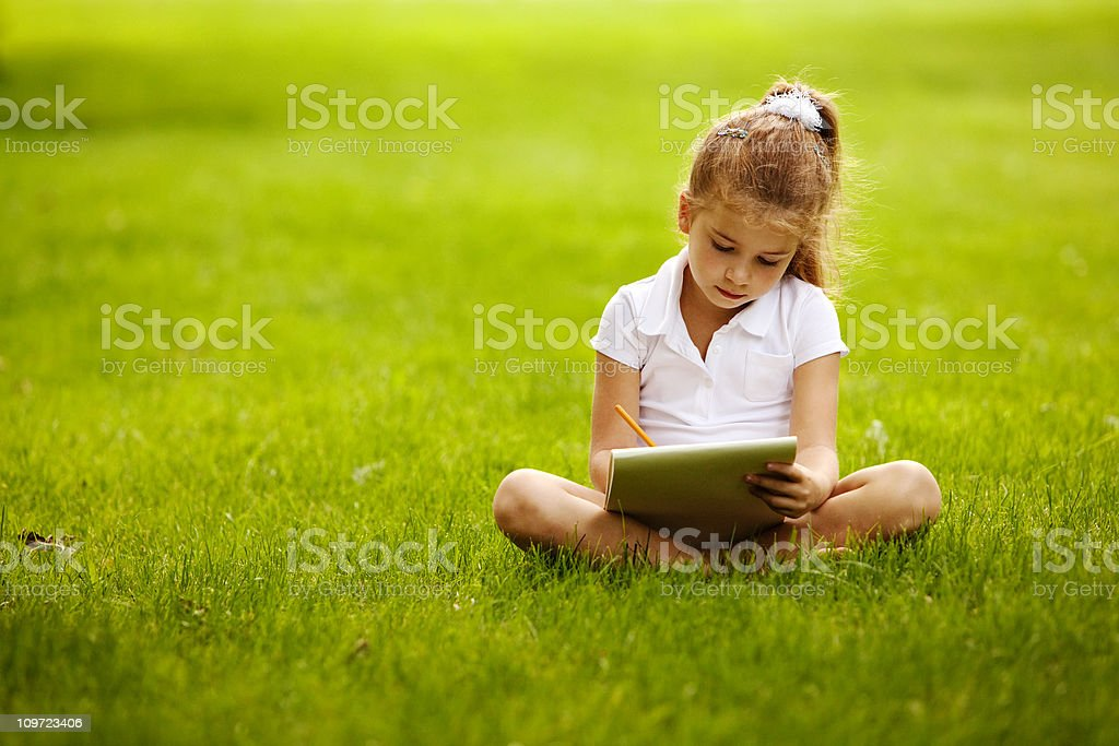 Little girl drawing in park royalty-free stock photo