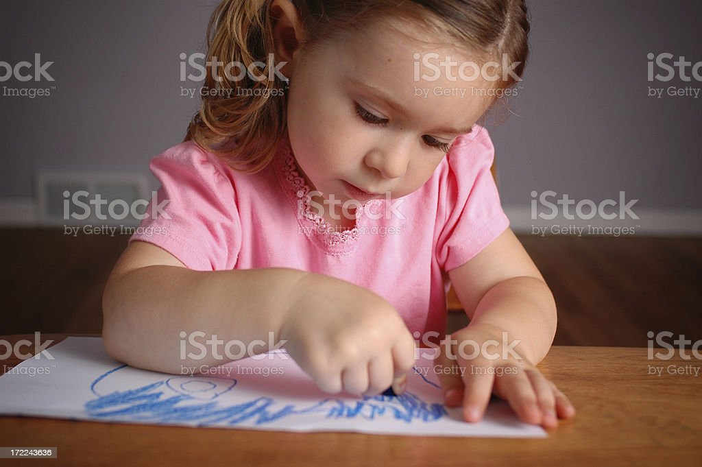 Little Girl Drawing on Paper in School Desk royalty-free stock photo