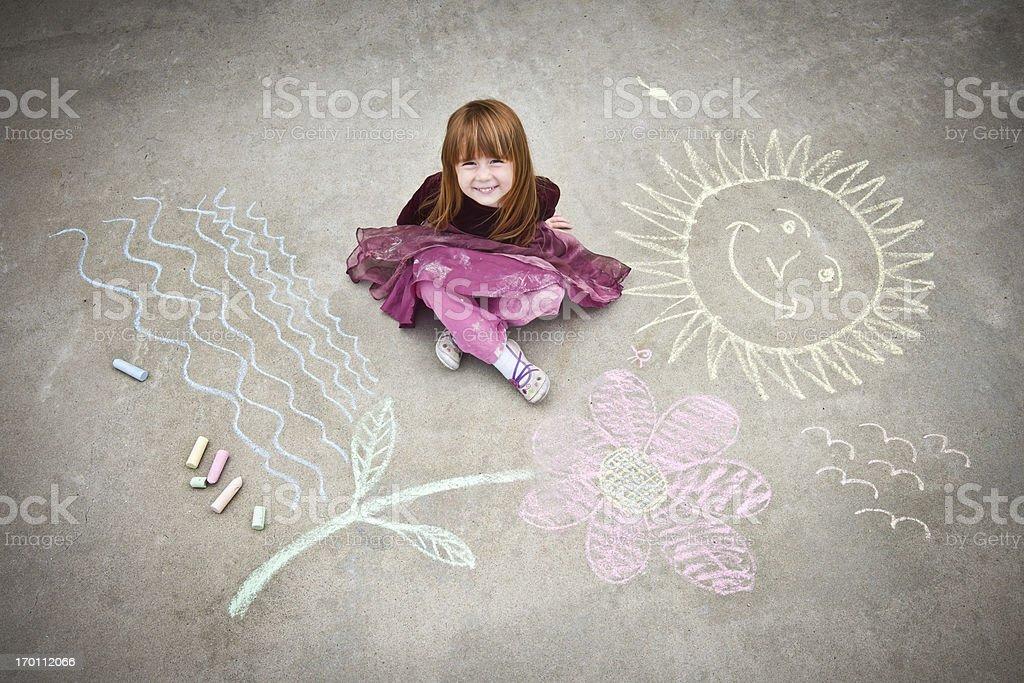 Little Girl Drawing on Sidewalk stock photo