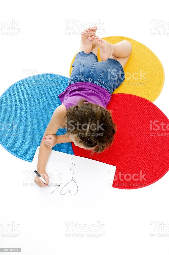 Little Girl Drawing on the Floor royalty-free stock photo