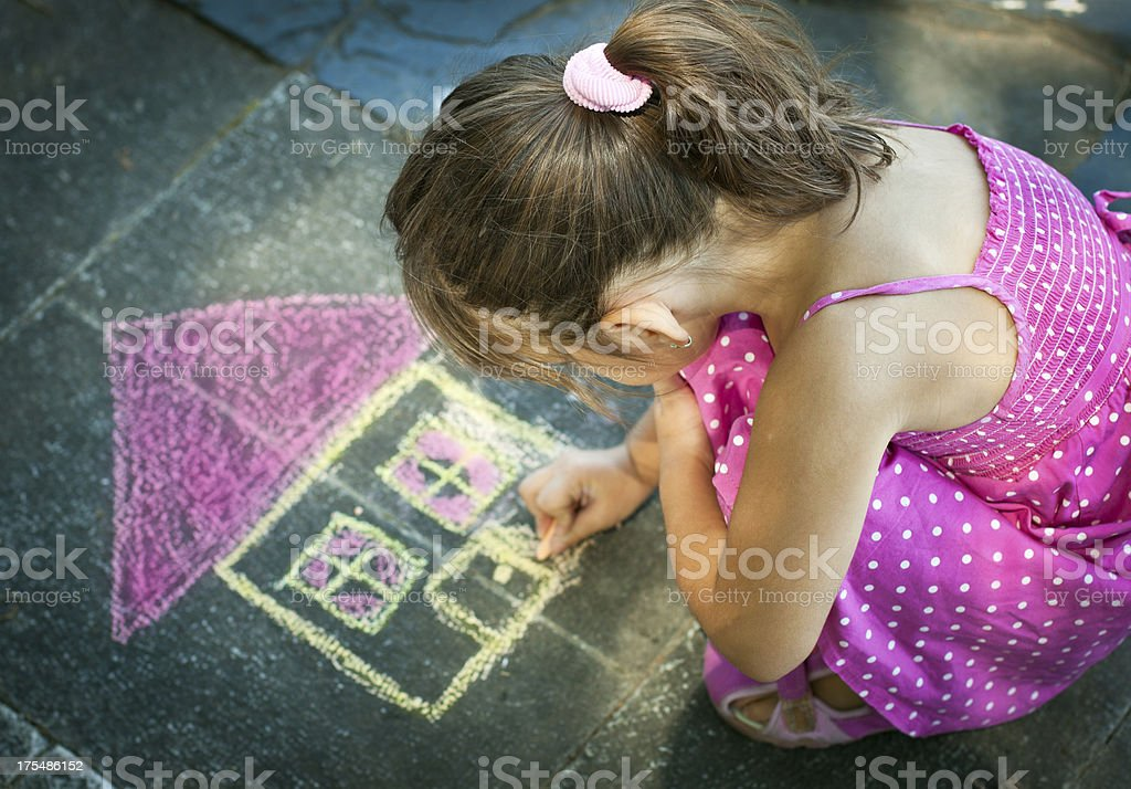 Little Girl Drawing on the sidewalk stock photo