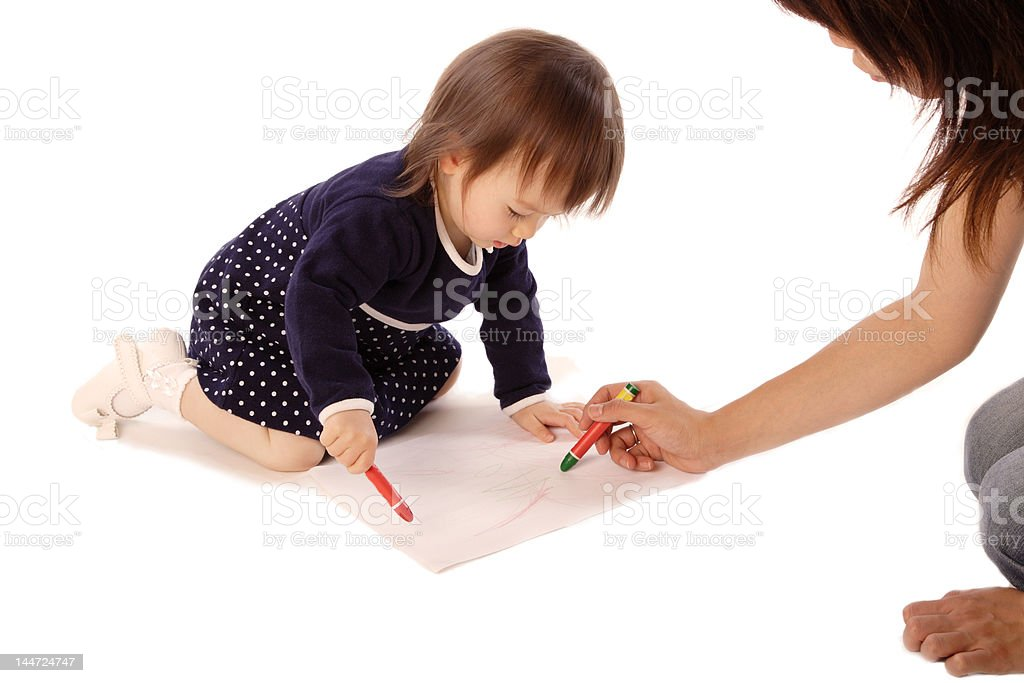 Little girl drawing together with mother royalty-free stock photo
