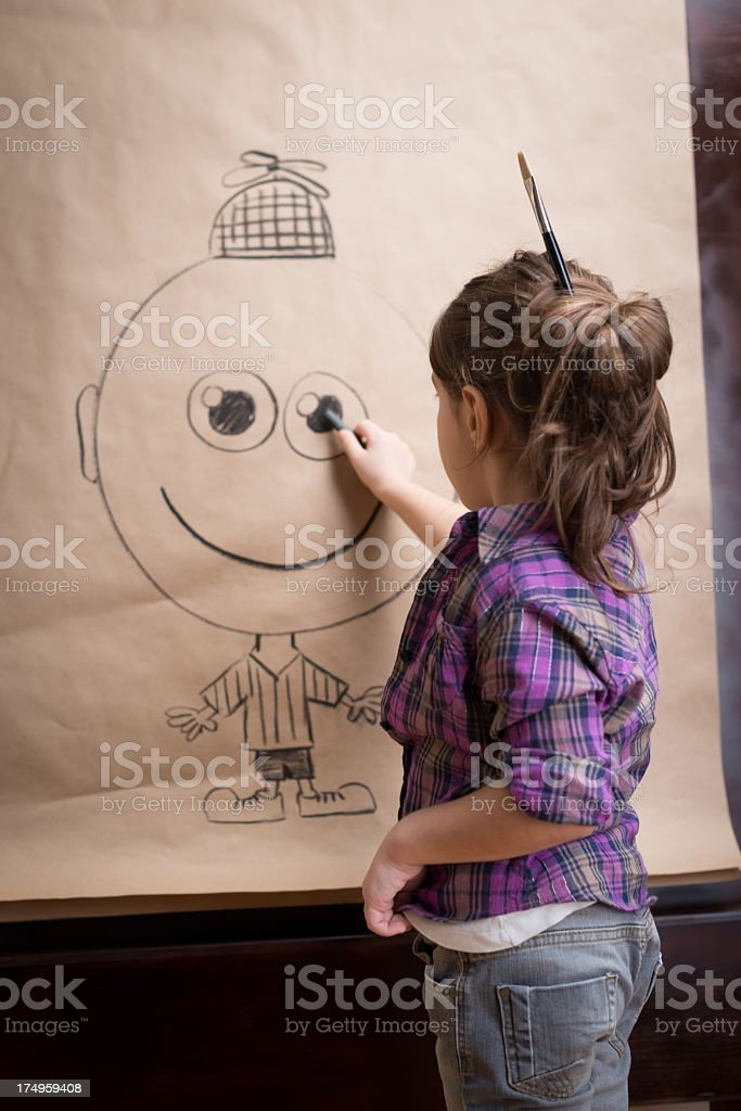Little girl drawing with Charcoal royalty-free stock photo