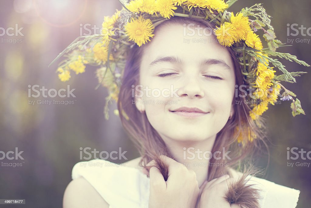 Little girl dreaming in the park stock photo