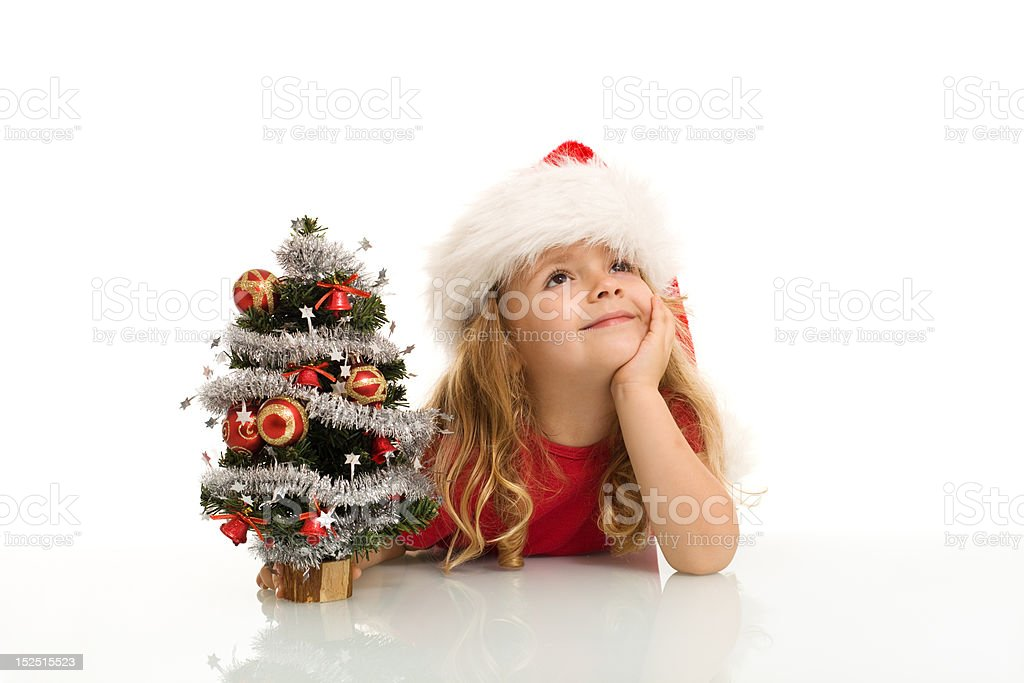 Little girl dreaming of a white christmas royalty-free stock photo