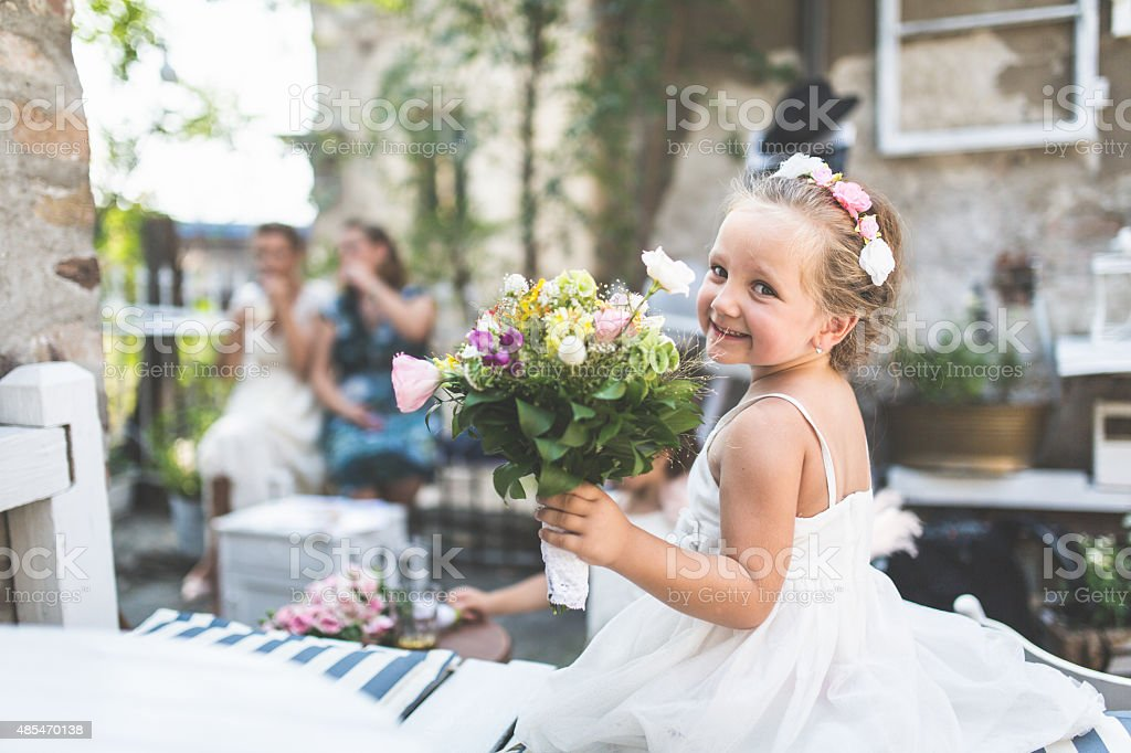 Little girl dressed as a bride stock photo