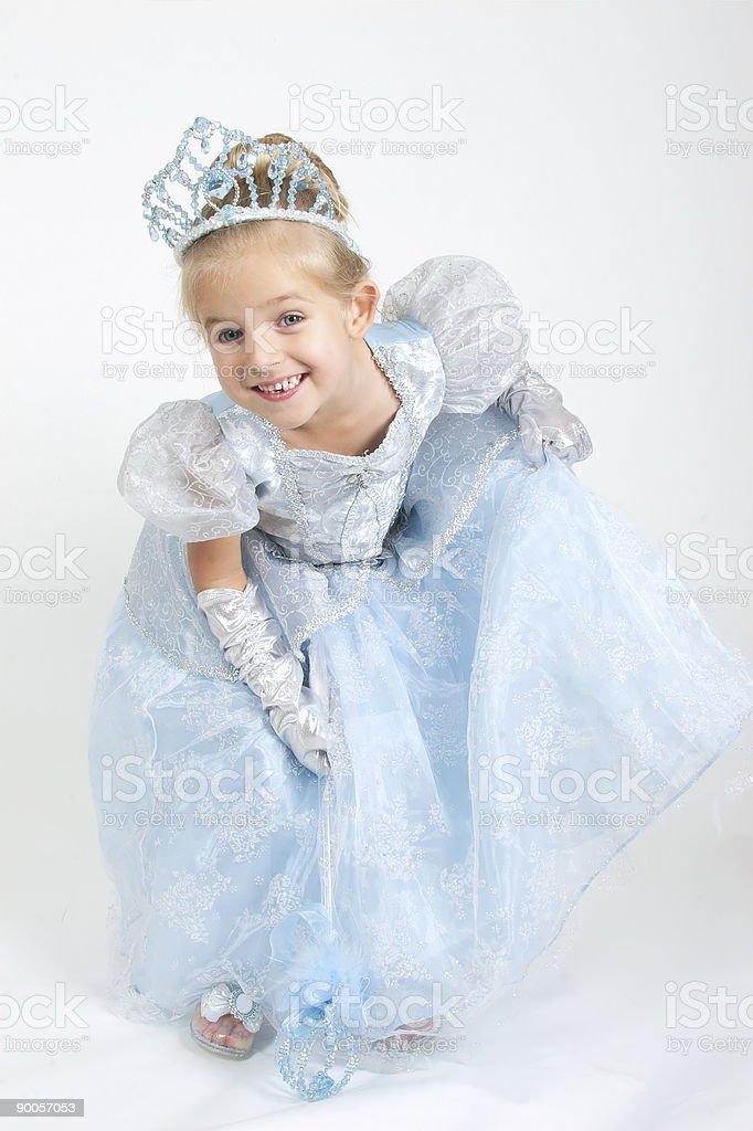 A little girl dressed as a princess bowing and smiling stock photo