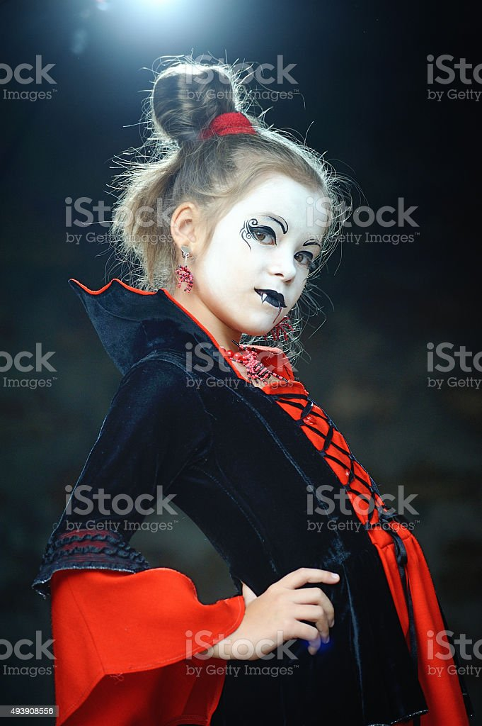 little girl dressed as a vampire Gothic Halloween stock photo