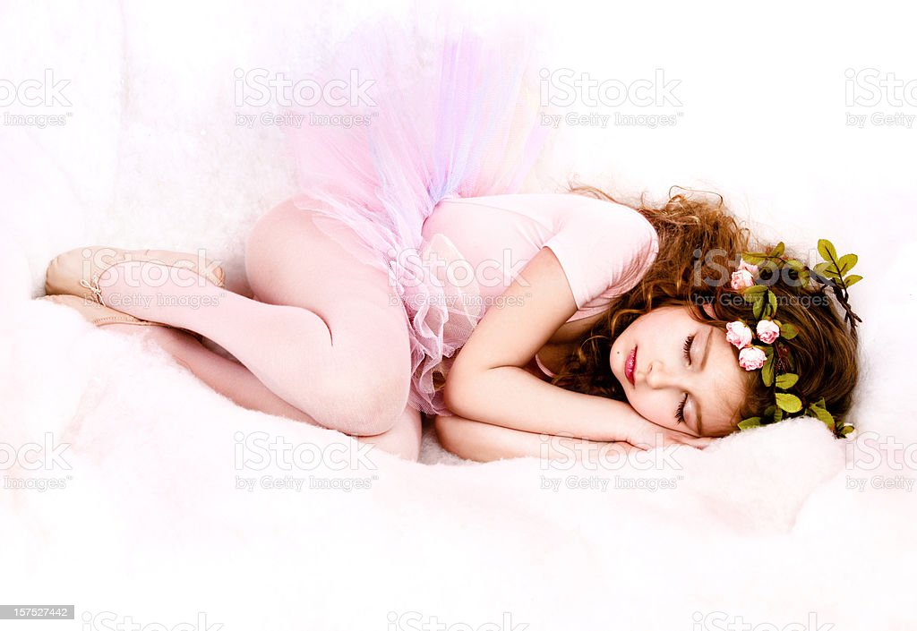 Little girl dressed in a fairy costume, sleeping stock photo