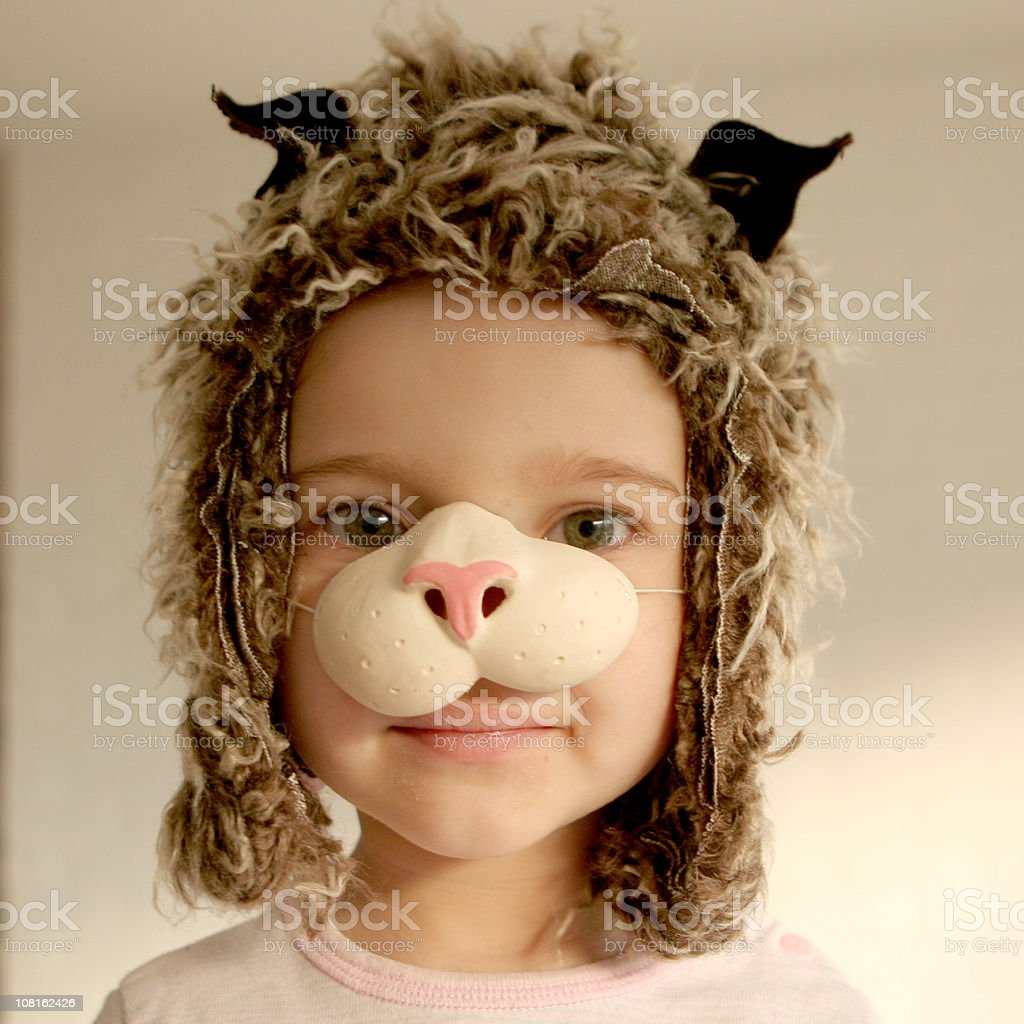 Little Girl Dressed in Cat Costume stock photo