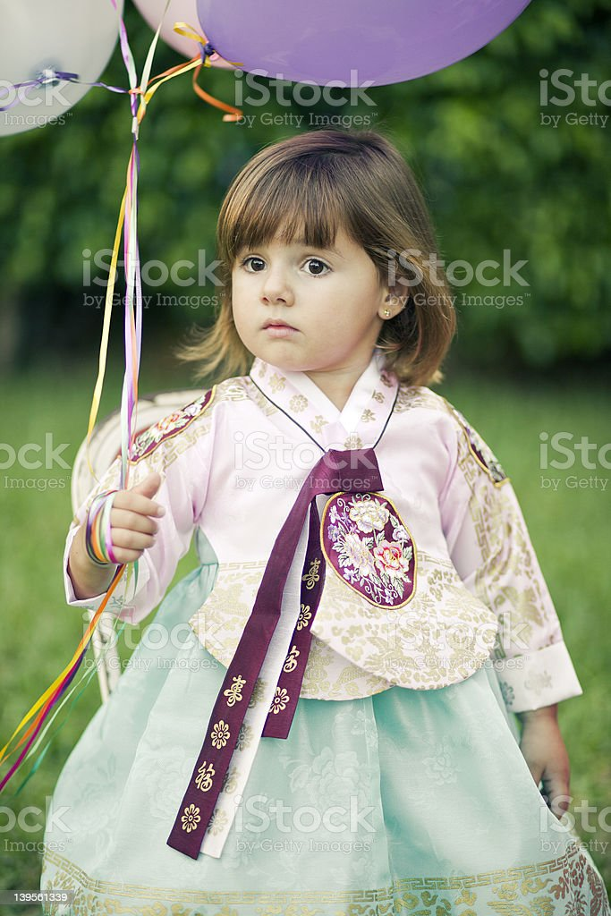 Little girl dressed in traditonal asian outfit royalty-free stock photo
