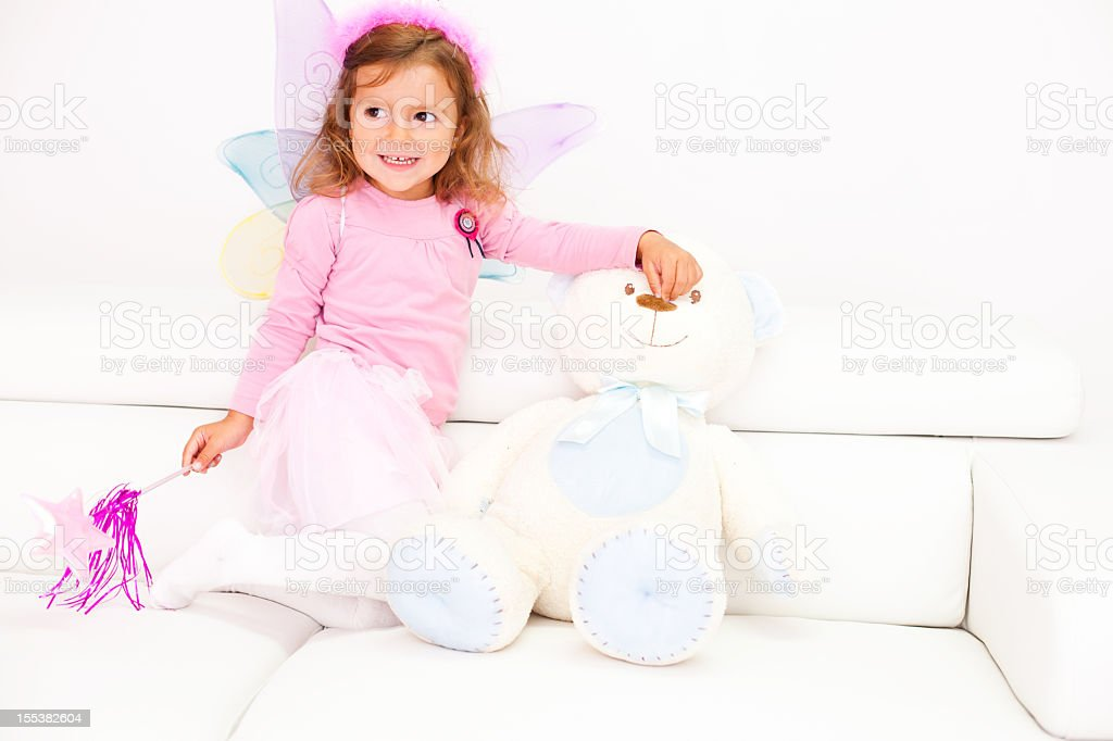 Little girl dressed up as a fairy royalty-free stock photo