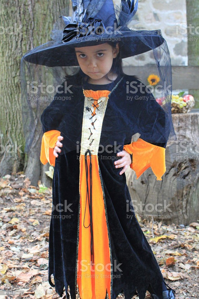 Little girl dressed up for Halloween eve stock photo