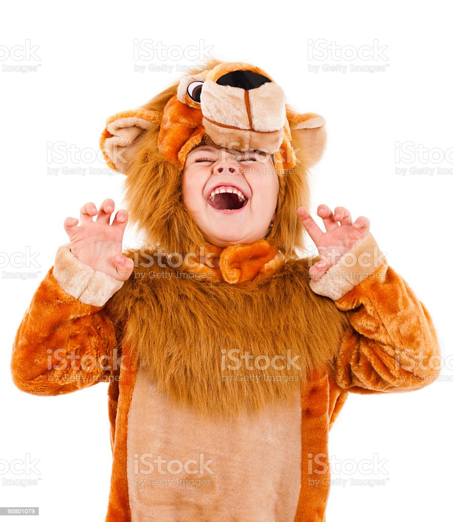 A little girl dressed up in a lion costume stock photo