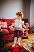Little Girl dressing up in the  Christmas Tinsel