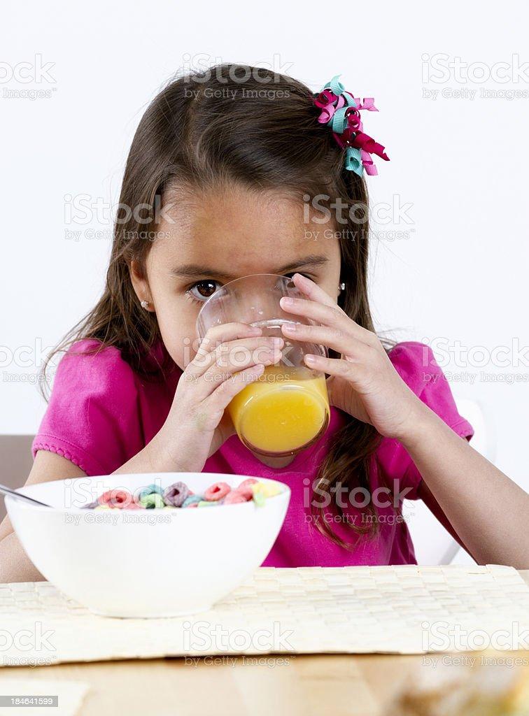 Little Girl Drinking Orange Juice royalty-free stock photo