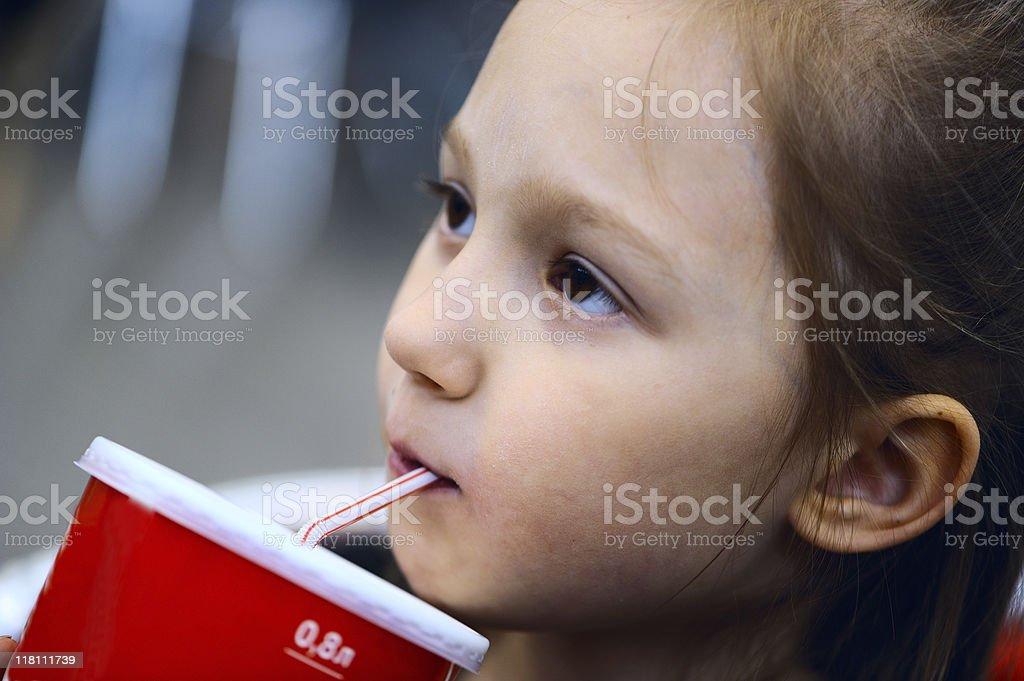 Little girl drinking soda royalty-free stock photo