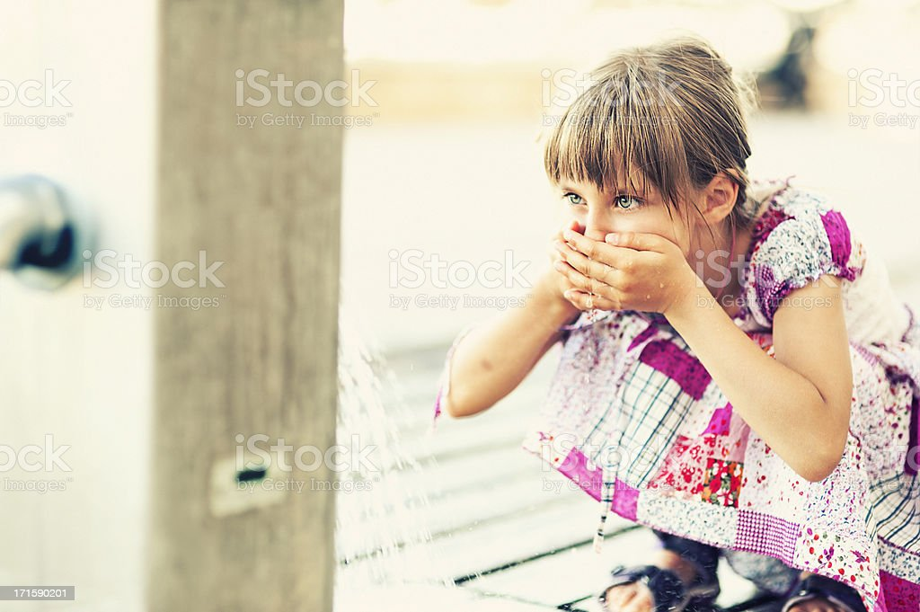 Little girl drinking water royalty-free stock photo