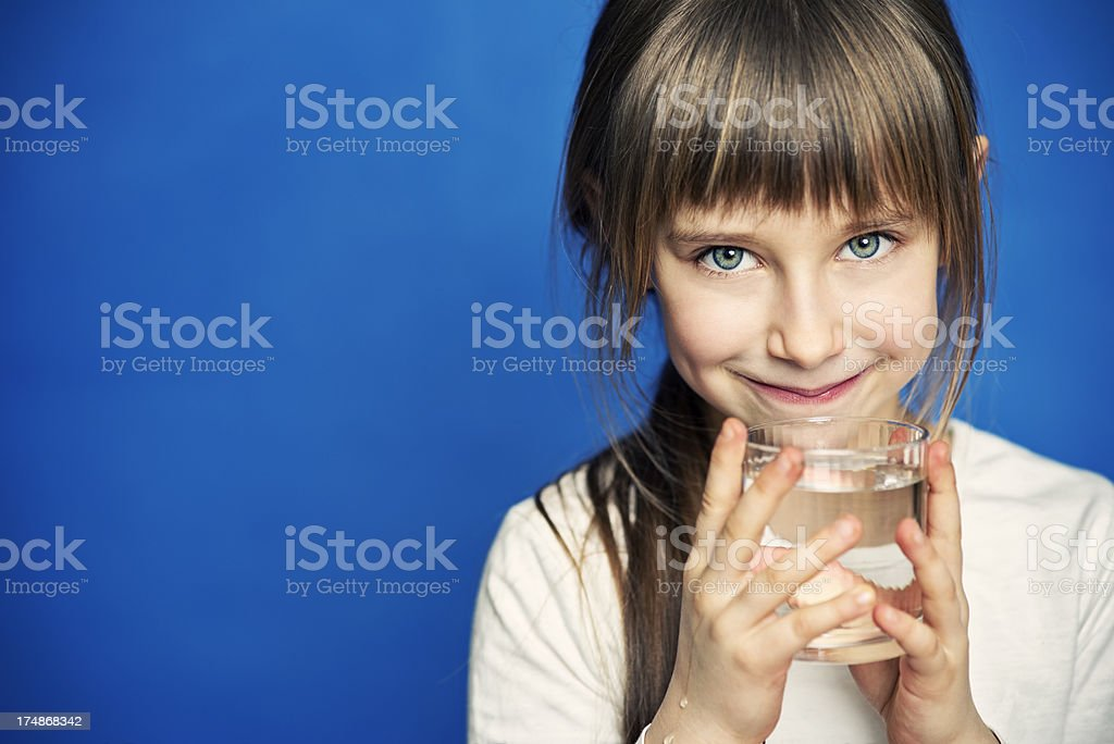 Little girl drinking water stock photo