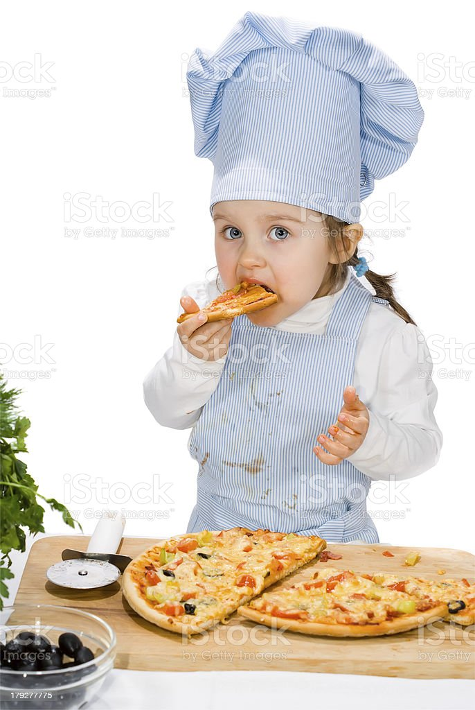 little girl eating a pizza with salami and vegetables royalty-free stock photo