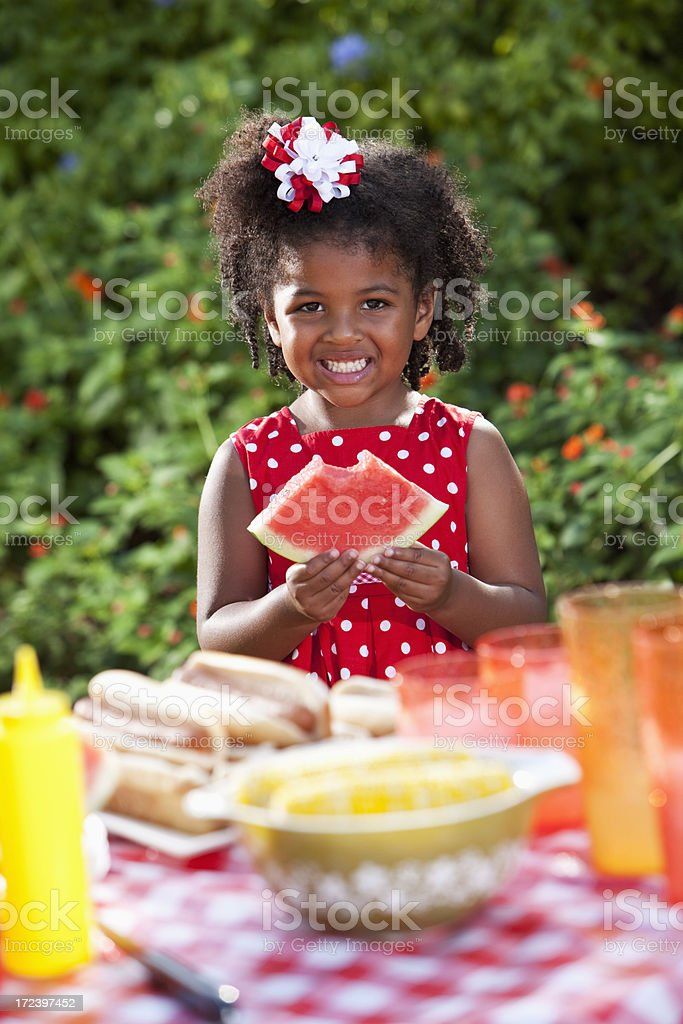 Little girl eating at picnic royalty-free stock photo