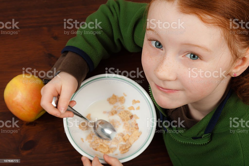 little girl eating breakfast cereal royalty-free stock photo