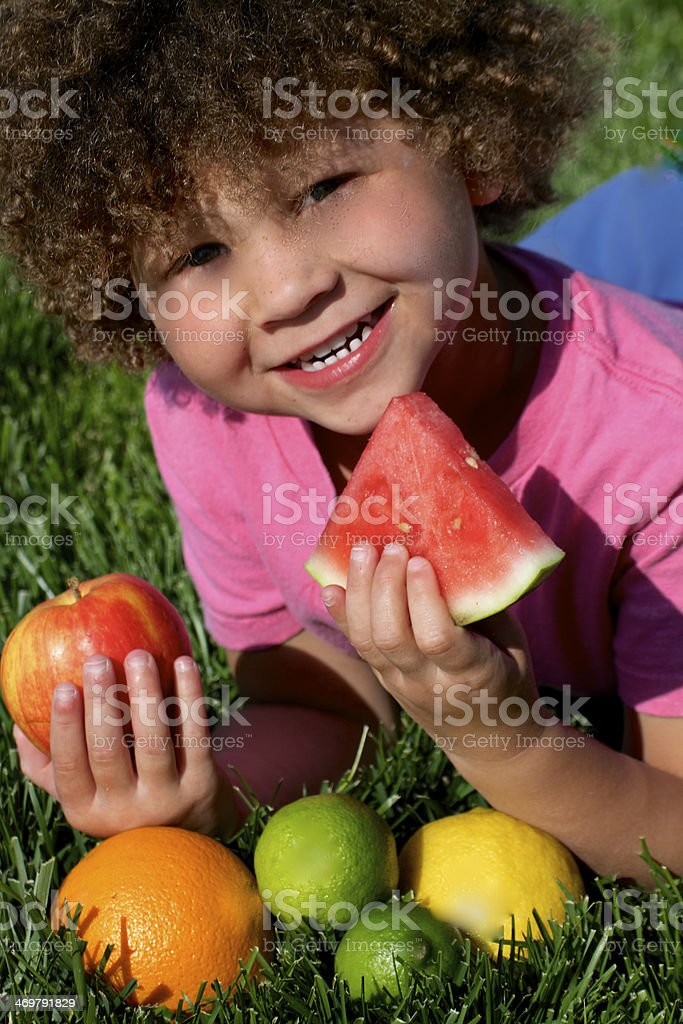 Little Girl Eating Fruit with big smile royalty-free stock photo