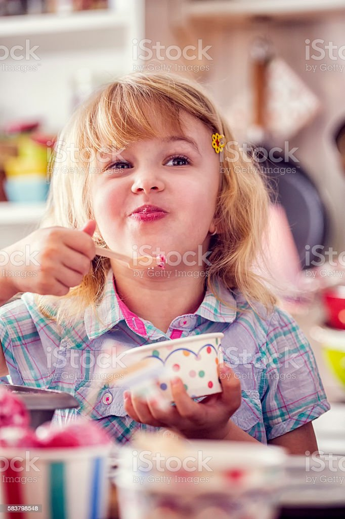 Little Girl Eating Homemade Strawberry Ice Cream stock photo