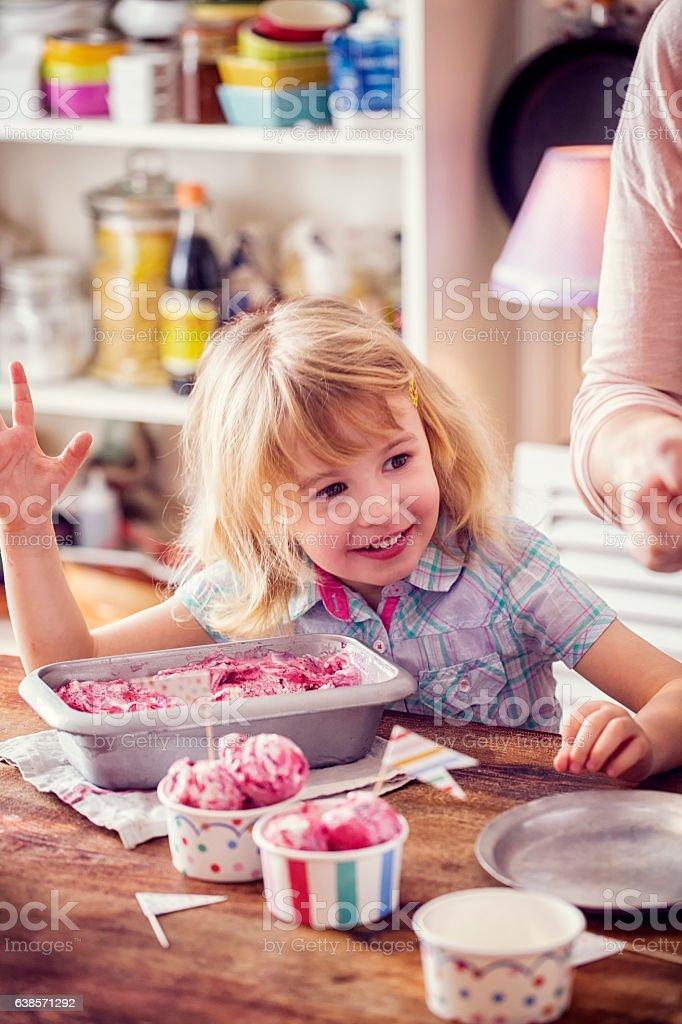Little Girl Eating Homemade Strawberry Ice Cream stock photo