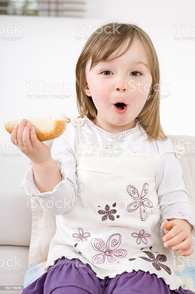 little girl eating royalty-free stock photo