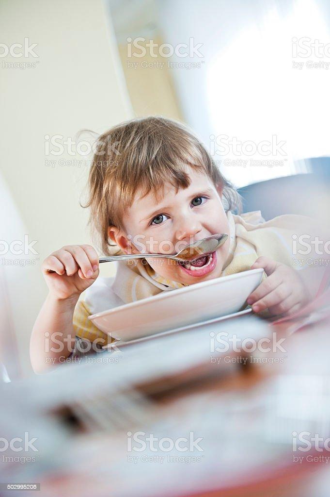 Little girl eating stock photo