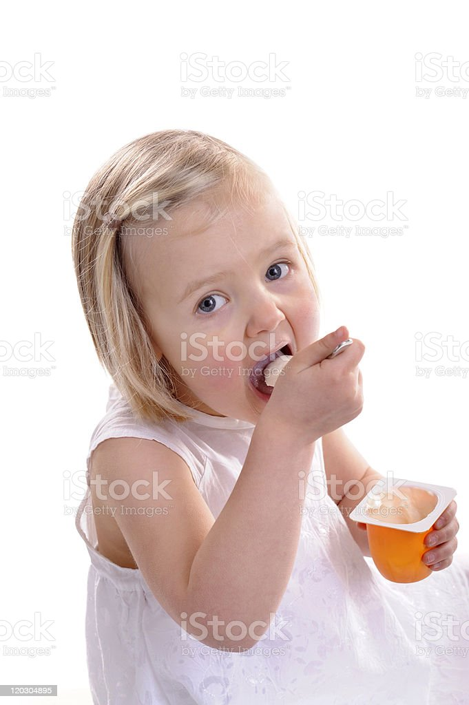little girl eating youghurt, mouth wide open royalty-free stock photo
