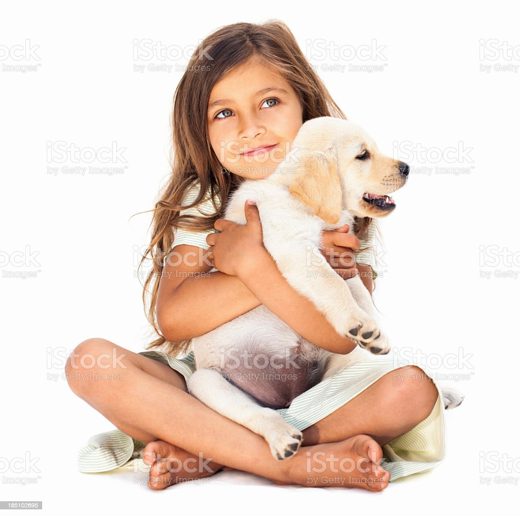 Little Girl Embracing Her Pet stock photo
