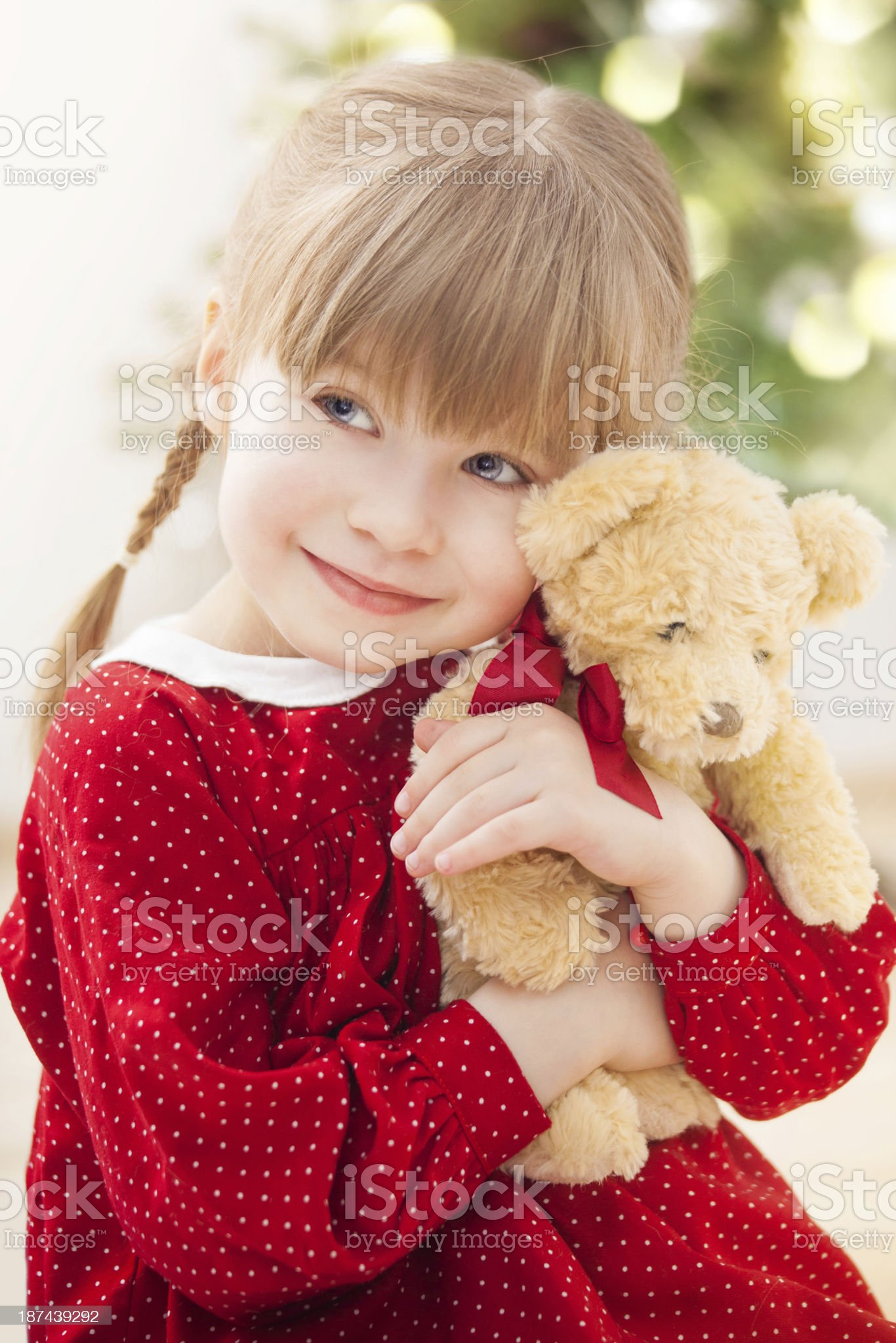 Little girl embracing teddy bear royalty-free stock photo