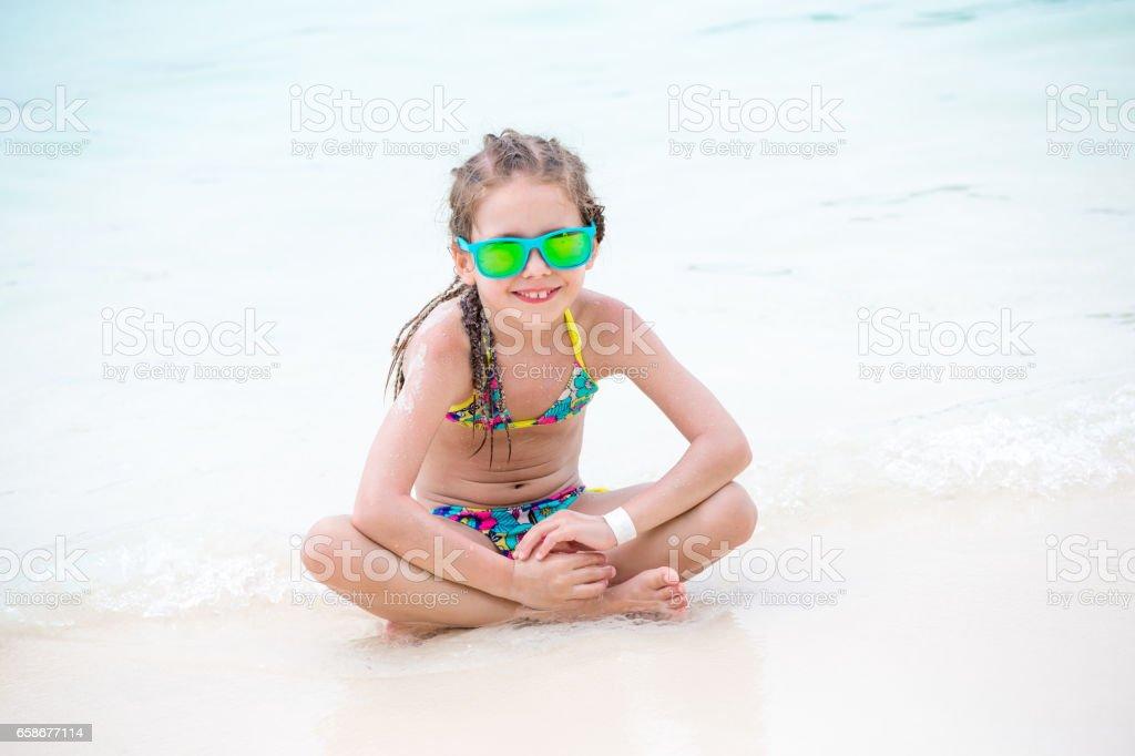 Little Girl Enjoy In The Sun On The Sandy Beach stock photo
