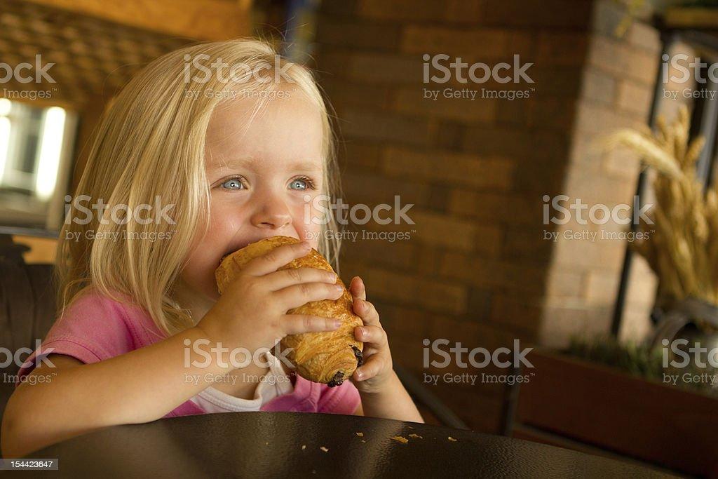 Little girl enjoying breakfast in the morning stock photo