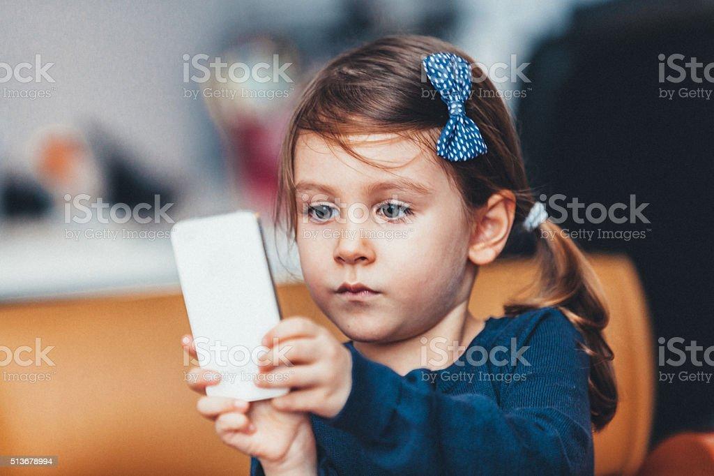 Little girl enjoying playing stock photo