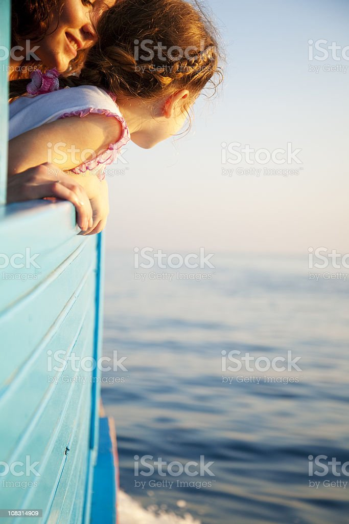 Little Girl Enjoying Sailing with Mom royalty-free stock photo