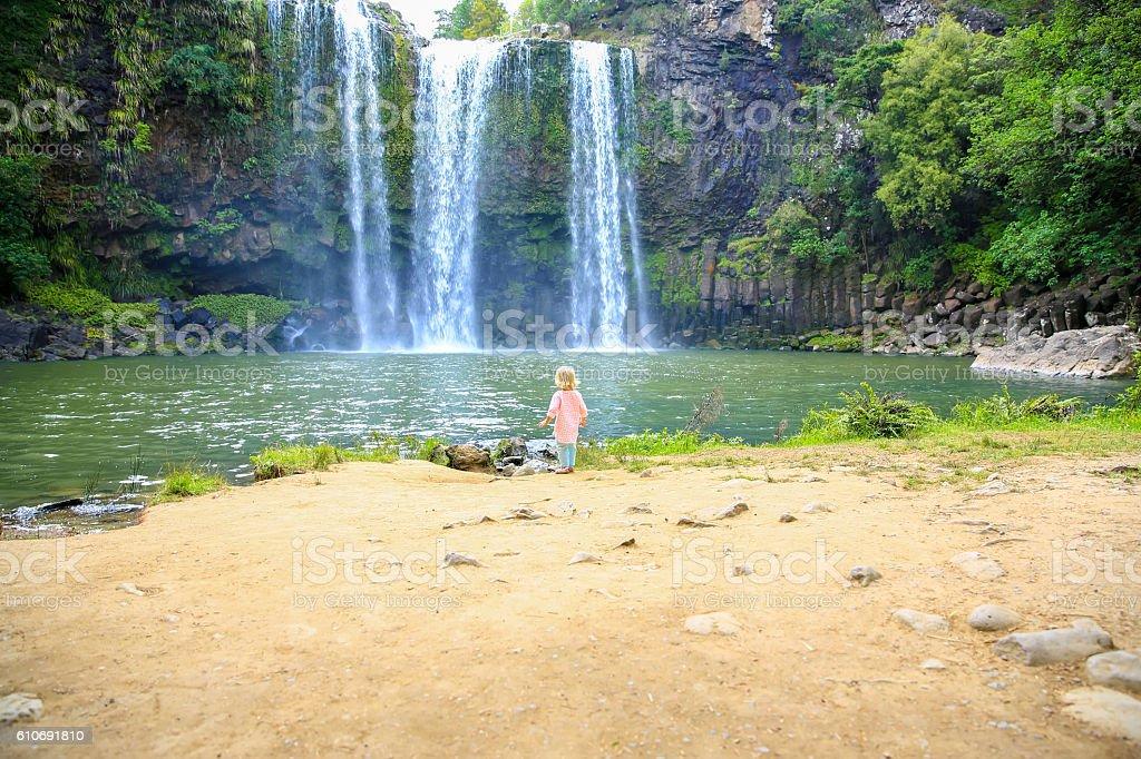 Little girl enjoying Spectacular view of Whangarei Falls,  New Zealand stock photo