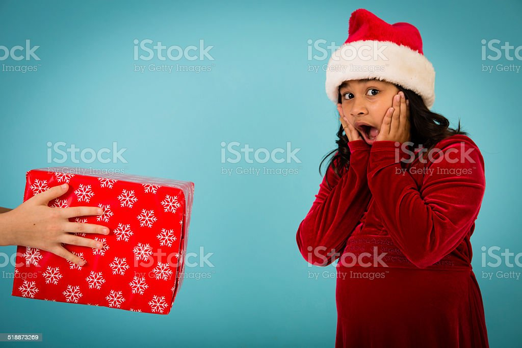 Little Girl Excited About Receiving a Christmas Present stock photo