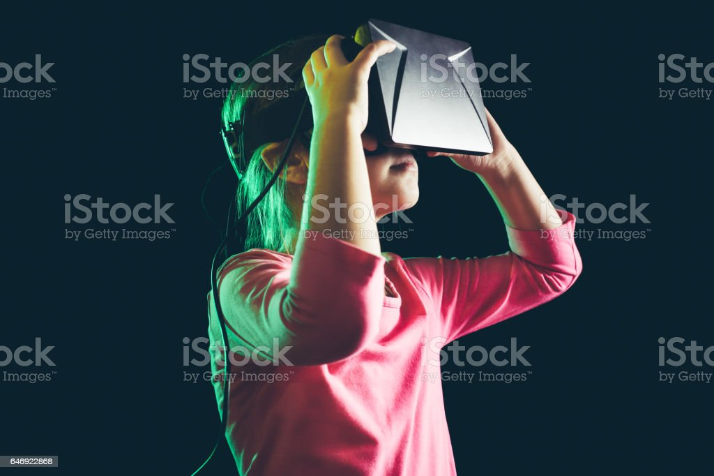 Little girl experience with VR headset stock photo
